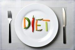 Suivez un régime écrit avec des légumes dans le concept sain de nutrition Photo libre de droits