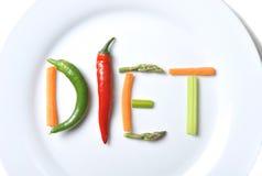 Suivez un régime écrit avec des légumes dans le concept sain de nutrition Image libre de droits