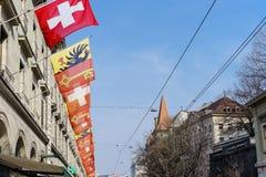 Suizo y banderas de Ginebra Foto de archivo