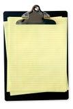 Sujetapapeles con el papel de carta amarillo Fotografía de archivo