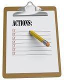 Sujetapapeles con la lista de las acciones y el lápiz rechoncho Foto de archivo