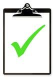 Sujetapapeles con la señal verde Imagen de archivo