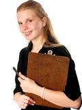 Sujetapapeles de la mujer joven Imagen de archivo