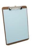 Sujetapapeles y papel azul Fotografía de archivo