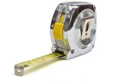 Sujete con cinta adhesiva la regla Imagen de archivo libre de regalías