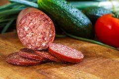 Sujuk sausage on cutting board Stock Photography