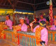 Sukawati, Bali, Indonesia - December 28, 2008: Traditional Balinese musicians playing on music instrument gamelan Royalty Free Stock Image