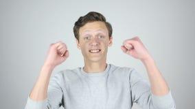 Sukces, wygrana, Odizolowywający gest podniecenie młodym człowiekiem zbiory