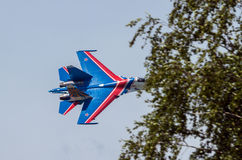 Sukhoi-27 fighter  in flight at low altitude Royalty Free Stock Photos