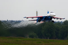 Sukhoi Su-27 of Aerobatics team Russian Knights jet fighter takes off at Kubinka air force base during Army-2015 forum. KUBINKA, MOSCOW REGION, RUSSIA - JUNE 19 Stock Photography