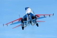 Sukhoi Su-27 04 BLUE jet fighter of Russian Knights aerobatics team landing at Kubinka air force base. Royalty Free Stock Image