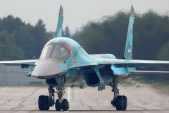 Sukhoi Su-34 bomber at Kubinka air force base during Army-2015 forum, Moscow region, Russia. KUBINKA, MOSCOW REGION, RUSSIA - JUNE 19, 2015: Sukhoi Su-34 bomber Royalty Free Stock Photo