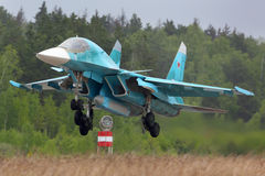 Sukhoi Su-34 bomber landing at Kubinka air force base, Moscow region, Russia. KUBINKA, MOSCOW REGION, RUSSIA - MAY 18, 2015: Sukhoi Su-34 bomber landing at Royalty Free Stock Image