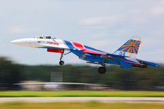 Sukhoi Su-27 jet fighter taking off at Kubinka air force base. KUBINKA, MOSCOW REGION, RUSSIA - MAY 28, 2011: Sukhoi Su-27 jet fighter taking off at Kubinka air Royalty Free Stock Image