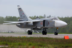 Sukhoi SU-24 RF-92245 bomber of Russian Air Force taxiing at Kubinka air force base. KUBINKA, MOSCOW REGION, RUSSIA - MAY 18, 2015: Sukhoi SU-24 RF-92245 bomber Stock Image