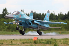 Sukhoi SU-34 RF-92252 of russian air force bomber landing at Kubinka air force base during Army-2015 forum. KUBINKA, MOSCOW REGION, RUSSIA - JUNE 22, 2015 Royalty Free Stock Images