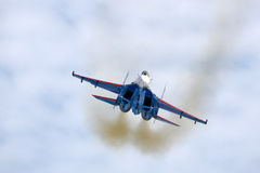 Sukhoi Su-27 of russian knights aerobatics team jet fighter showing demonstartion flight at Kubinka air force base. Royalty Free Stock Image