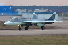 Sukhoi T-50 PAK-FA 055 BLUE prototype is a brand new fifth generation jet fighter shown while arriving Zhukovsky. ZHUKOVSKY, MOSCOW REGION, RUSSIA - NOVEMBER 20 Royalty Free Stock Images