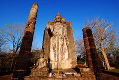 Sukhotai standing Buddha in blue sky Royalty Free Stock Images