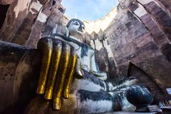 Buddha Statue with gold finger in Sukhothai Historical Park Royalty Free Stock Image