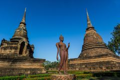 buddha statue with blue sky at Sukhothai Historical Park Royalty Free Stock Images
