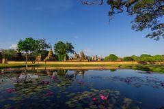 Temple pagoda and buddha statue with blue sky at Sukhothai Historical Park Stock Image