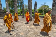 Sukhothai Ruins Buddhist Monks, Thailand. A group of buddhist monks walking and smiling during a visit in one of the buddhist temples and ruins of Sukhothai stock images