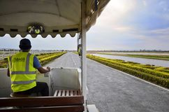 Ground services on the bus and going to the airplane for take off at Sukhothai airport Stock Photos