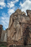 Sukhothai walking Buddha image. In Si Satchanalai Stock Photo