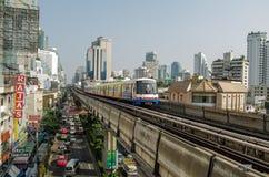 Sukhumvit Road, Bangkok. BANGKOK, THAILAND - OCTOBER 26: Skytrain travelling over the congested Sukhumvit Road in central Bangkok on October 26 2013.  The Royalty Free Stock Image