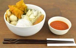 Suki meal set.Asian food style. Suki set serve with spicy suki sauce.Asian food style.Wooden background royalty free stock image