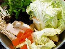 Suki Shantou with vegetables and eggs pork ,Shantou, China Shabu set and mixed vegetables on white backgrounds.  royalty free stock photos