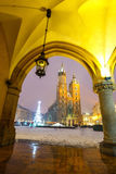 Sukiennice and St. Mary`s Church at night in Krakow Stock Photography