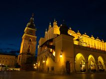 Sukiennice and Town Hall Tower in Krakow by night Stock Photos