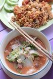 Sukiyaki and Fried rice. On purple table Royalty Free Stock Photography