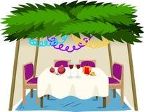Sukkah för Sukkot med mat på tabellen Arkivfoto