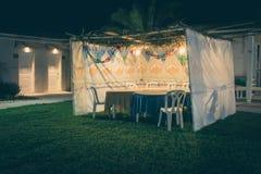 Sukkah - symbolic temporary hut for celebration of Jewish Holiday Sukkot Royalty Free Stock Image