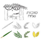 Sukkah with table, food and Sukkot symbols Royalty Free Stock Photo