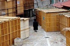 Sukkot Jewish Holiday in Mea Shearim Jerusalem Israel. JERUSALEM - OCT 20:Orthodox Jewish man walks between Sukkah booths during Sukkot  Jewish holiday in Mea Royalty Free Stock Images