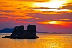 Sukosan old ruin on the sea sunset view Stock Image
