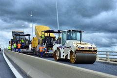 Sul sito di lavoro - porre asfalto Fotografia Stock Libera da Diritti
