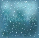 Sul vetro con le gocce dell'autunno di parola Fotografia Stock