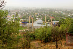 Sulayman Too mosque in Osh city, Kyrgyzstan. Sulayman Too mosque lockated near Sulayman Too mountain - well-known places of Muslim pilgrimage royalty free stock photo
