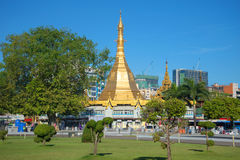 Sule Pagoda against the backdrop of modern Yangon Stock Image