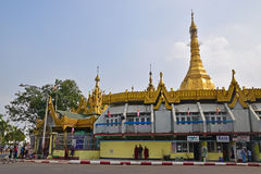 Sule Pagoda in Yangon, Myanmar with small shops around the sacred building. Stock Photo
