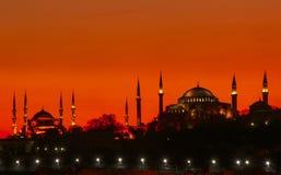Suleymaniye and Hagia Sophia. Hagia sophia and Suleymaniye Orange Sky royalty free stock photo