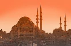 Suleymaniye Mosque. Scenic view of Suleymaniye Mosque with orange sunset background Stock Images