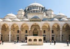 Suleymaniye Mosque interior court with tourists. Suleymaniye Mosque seen from the interior court Stock Photos