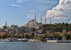 Suleymaniye mosque in Istanbul with blue sky. View of Suleymaniye mosque in Istanbul with blue sky from the bay royalty free stock photography