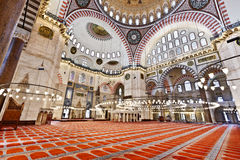 Suleymaniye Mosque in Istanbul Turkey - interior. Suleymaniye Mosque (Ottoman Imperial mosque) interior ornate architecture in Istanbul, Turkey Stock Photo